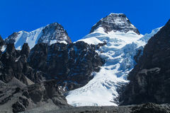 Snow covered high mountain in Andes stock photos