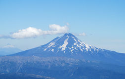 Snow covered hight volcano in Chile royalty free stock images