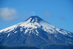 Snow covered hight volcano top Royalty Free Stock Images