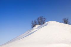 The snow-covered hill Stock Images