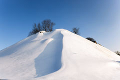 Snow covered hill Stock Photos