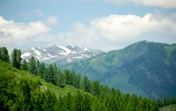 Snow-covered hills of the high mountains Stock Photography