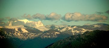 Snow-covered hills of the high mountains Royalty Free Stock Images