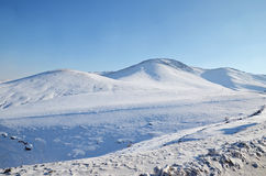 Snow-covered hills. Mongolian winter landscape Stock Images