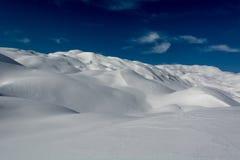 Snow covered hills. Resembling desert dunes Royalty Free Stock Photos