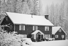 Snow covered home in forest. In winter Royalty Free Stock Photo