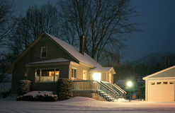Snow covered home night scene Royalty Free Stock Image