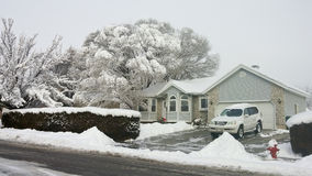 Snow Covered Home in Utah Royalty Free Stock Image