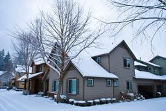 Snow covered Homes Royalty Free Stock Photography