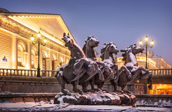 Snow-covered horses. Stone horses gallop rush snowy morning in Alexandrovsky Garden Royalty Free Stock Images