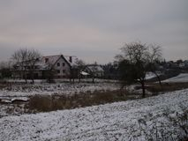 Snow covered house and beautiful landscape - winter season - christmas royalty free stock images