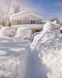Snow Covered House from Blizzard. A house, roof and cars are covered with deep white snow in western new york for a weather or blizzard concept Royalty Free Stock Photo