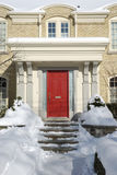 Snow covered house entrance Stock Images