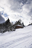 Snow covered house in a frosty mountains country in sunny day Royalty Free Stock Photography