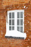 Snow covered house window. Snow in winter covers the window of an old brick house in England Royalty Free Stock Photo