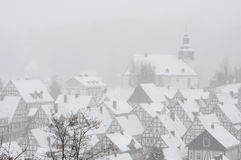 Snow-covered houses in German town Stock Images