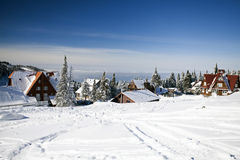 Snow covered houses in the mountains Royalty Free Stock Photography