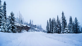Snow covered houses and streets in a neighborhood of the alpine village of Sun Peaks Stock Images
