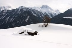 Snow covered hut. In mountains (Switzerland Stock Images