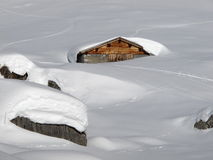 Snow covered hut in Braunwald. Glarus Canton Royalty Free Stock Photo