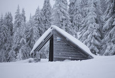 Snow covered. Hut in the mountains Stock Photos