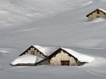 Snow covered huts Stock Image