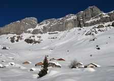 Snow covered huts in the Swiss Alps Stock Photo