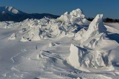Snow-covered ice hummocks of Lake Baikal Royalty Free Stock Image