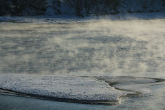 Snow-covered island. Snow-covered island on the lake Royalty Free Stock Photo