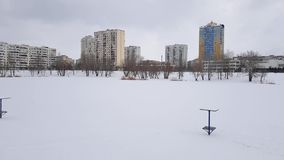 Snow-covered lake in the city. City leisure park in winter Kiev, Ukraine. March 21.2018 stock footage