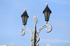 Snow-covered lampposts royalty free stock photo
