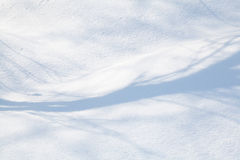 Snow-covered land closeup winter day Royalty Free Stock Image