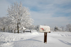 Snow Covered Landscape. Snow covered mailbox against a cold New England landscape stock photography