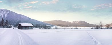 Snow Covered Landscape Against Mountain Range Royalty Free Stock Photos