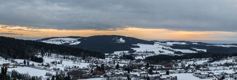 Snow covered Landscape of Bavarian forest with view to the alps, Bavaria, Germany.  royalty free stock photography