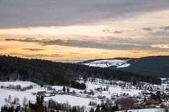 Snow covered Landscape of Bavarian forest with view to the alps, Bavaria, Germany.  royalty free stock image