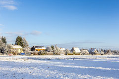 Snow-covered Landscape with Family Houses Royalty Free Stock Photos