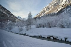 Snow covered landscape at the foot of the Matterhorn, a stream t stock photography