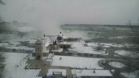 Snow covered landscape in front of Niagara Falls royalty free stock photo