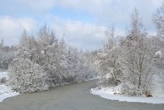 Snow-covered landscape with the river Royalty Free Stock Photos