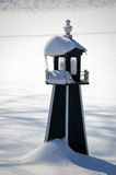 Snow Covered Lighthouse Stock Image