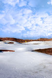 Snow covered links golf course with yellow flag Royalty Free Stock Photos