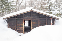 Snow covered log cabin Stock Photo