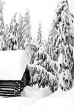 Snow Covered Log Cabin in the Woods Royalty Free Stock Photo