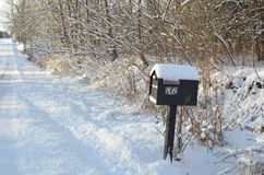 Snow covered mailbox snow morning rural road Stock Photo