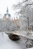 Snow covered mansion and bridge at winter park Stock Image