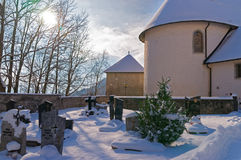 Snow-covered medieval cemetery near Gruyere castle Royalty Free Stock Image