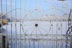 Snow-covered metal fence royalty free stock image