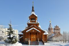 Snow-covered Moscow after a heavy snowfall. Old church of Holy Apostles Constantine and Elena in Mitino Royalty Free Stock Image