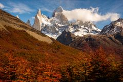 Snow-covered Mount Fitz Roy on beautiful fall day surrounded by lenga trees. Hiking in Los Glaciares National Park on a beautiful fall day, taking in the autumn royalty free stock photo